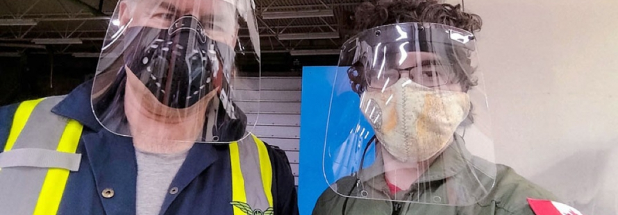 Gary David (left) and Danno Peters (right) wearing the Sask Shield face shields they designed together. | Photo: Danno Peters
